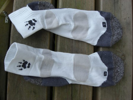 Observe both socks are differently shaped!